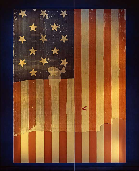 The original Star-Spangled Banner, which flew over Fort McHenry in 1814 and inspired the words of our National Anthem, hangs in Flag Hall of the National Museum of History and Technology, now the National Museum of American History.