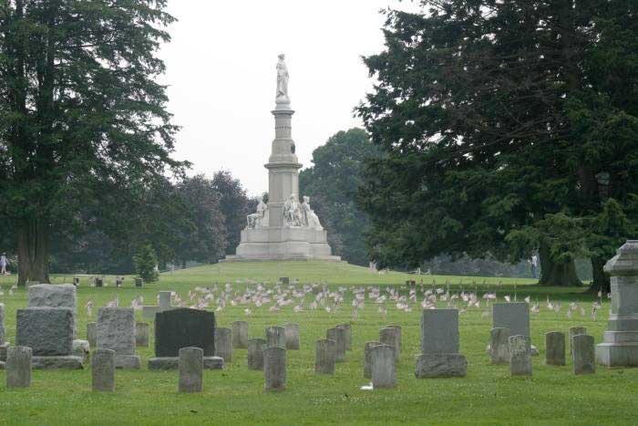 Soldiers National Monument at the center of Gettysburg National Cemetery, surrounded by tombstones.