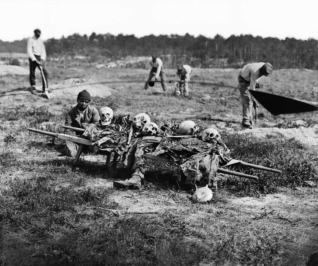 African Americans collecting bones of the soldiers killed in the battle at Cold Harbor, Va.
