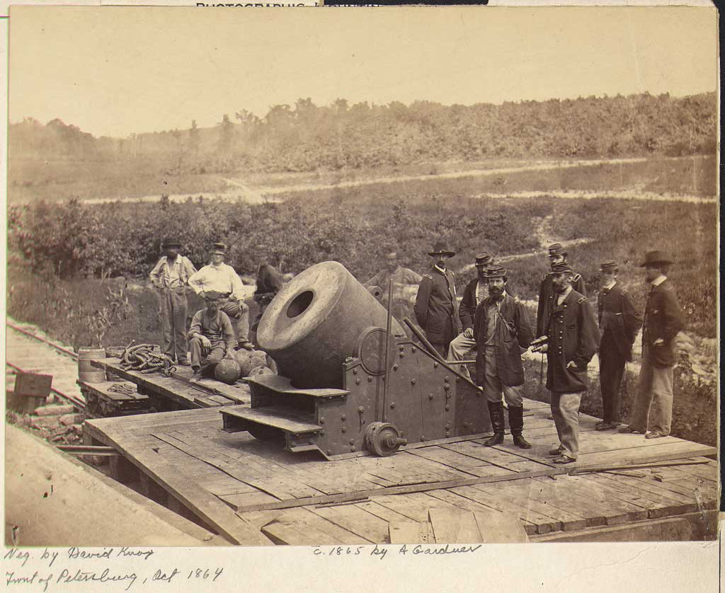 Group of soldiers standing around 'The Dictator,' a large mortar at Petersburg