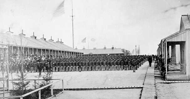 Photograph of the 26th Regiment, US Colored Troops standing at attention at Riker's Island, New York City, to fight in the U.S. Civil War.