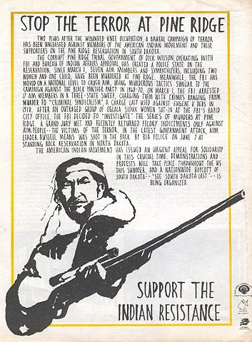 Poster has an image in the lower left of a man holding a gun. Next to the man is 'Support The Indian Resistance'. The top edge has 'Stop the Terror at Pine Ridge' and text below that details a massacre in South Dakota.