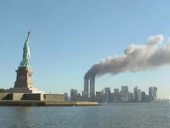 The Statue of Liberty appears to look on helplessly, as thick plumes of smoke obscure the Lower Manhattan skyline.
