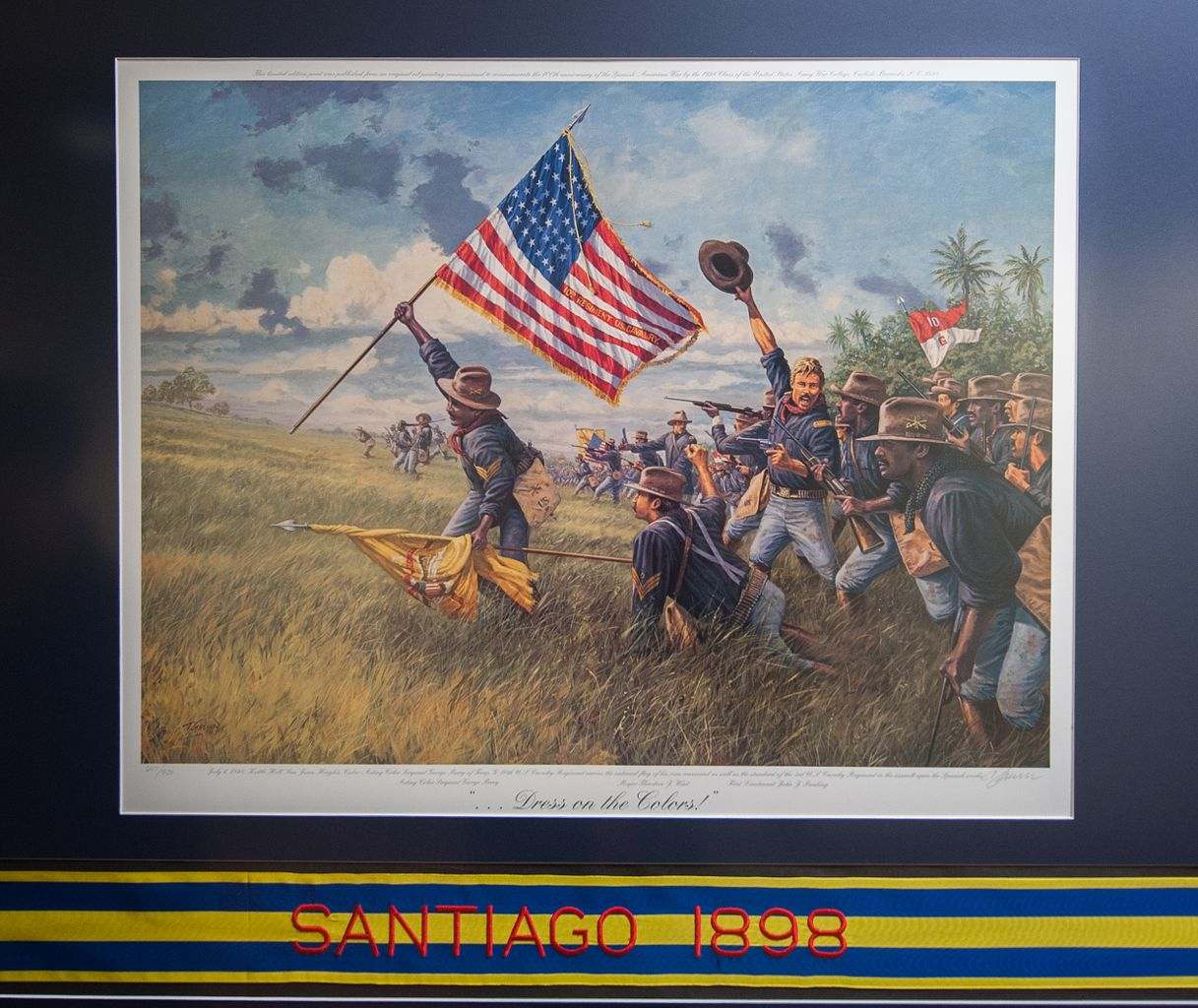 front line of an assault by the Buffalo Soldiers. An African-American man waves the US flag as the others get ready to engage in combat.