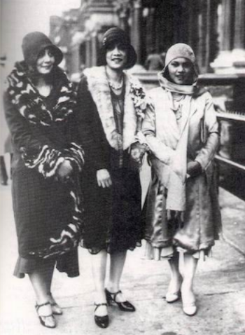 Three young African American women dressed in stylish 1920s dress.