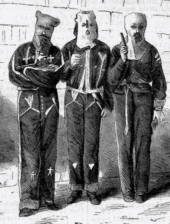 Three men dressed in dark clothing and white hoods pose jauntily.