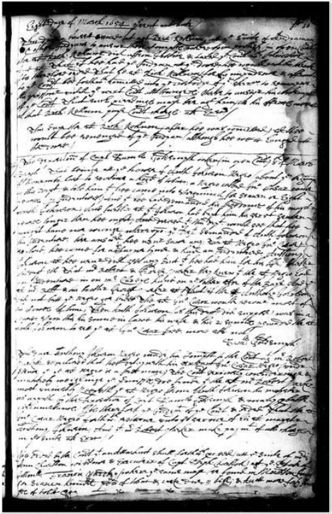 Illegible hand-written text on a black and white copy of a document with water stains.