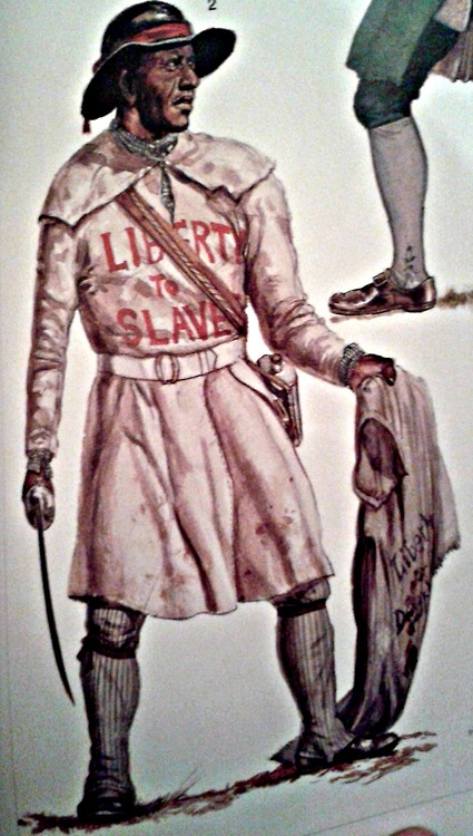Drawing of a single black man dressed in leggings and a frock that is belted at the waist. The words 'Liberty to Slaves is blazed onto the top of the frock. The man also wears a brimmed hat, and is carrying a coat in one hand and a sword in the other.