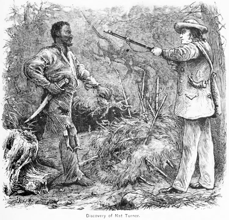 Nat Turner in the woods brandishing a knife and staring down a white man who is pointing a musket at him.