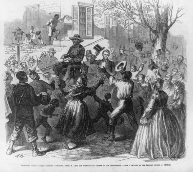 Lincoln in a carriage driven by a black man and being greeted by the city's black residents. The men are taking off their hats and holding them in the air. One woman is offering Lincoln flowers.