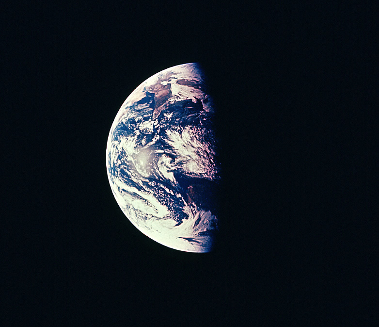 A view of Earth shows part of it is in daylight, part in nighttime.