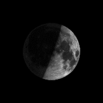 The right half of the lighted side of the moon is visible