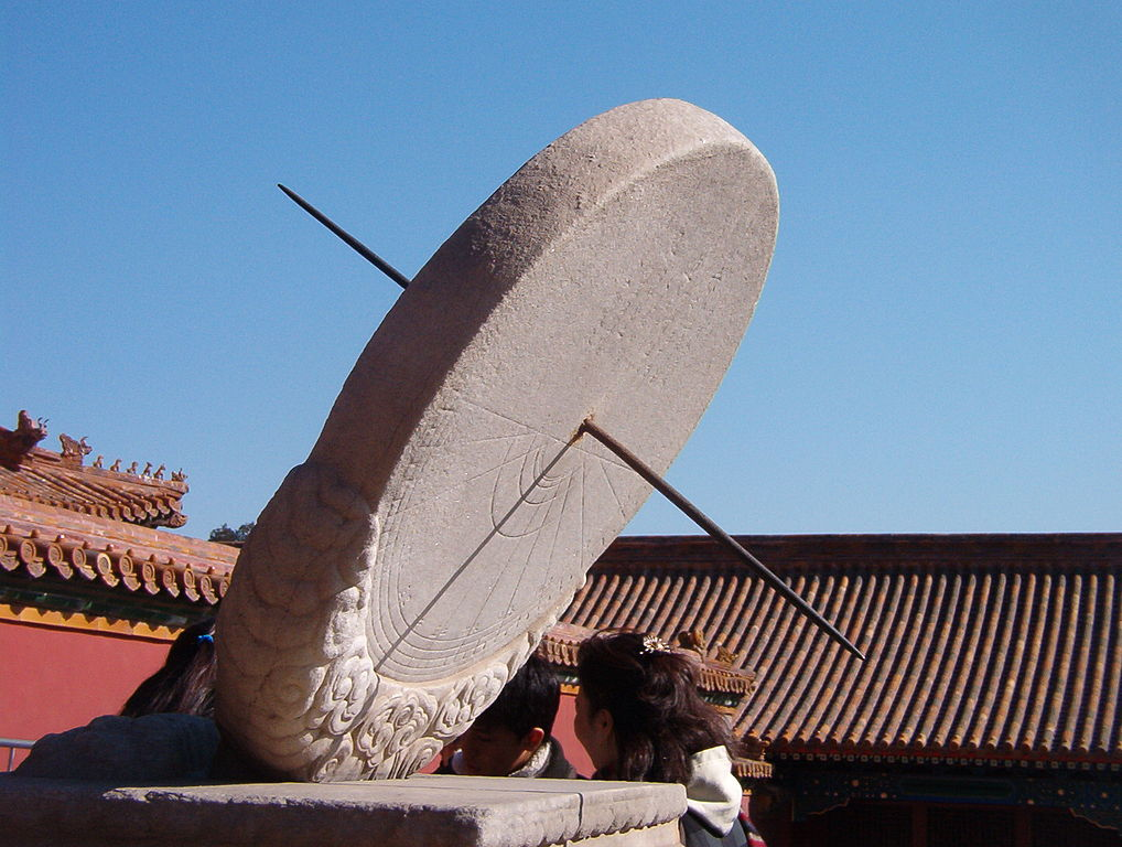 A large sundial made of stone and steel is shown in Beijing.
