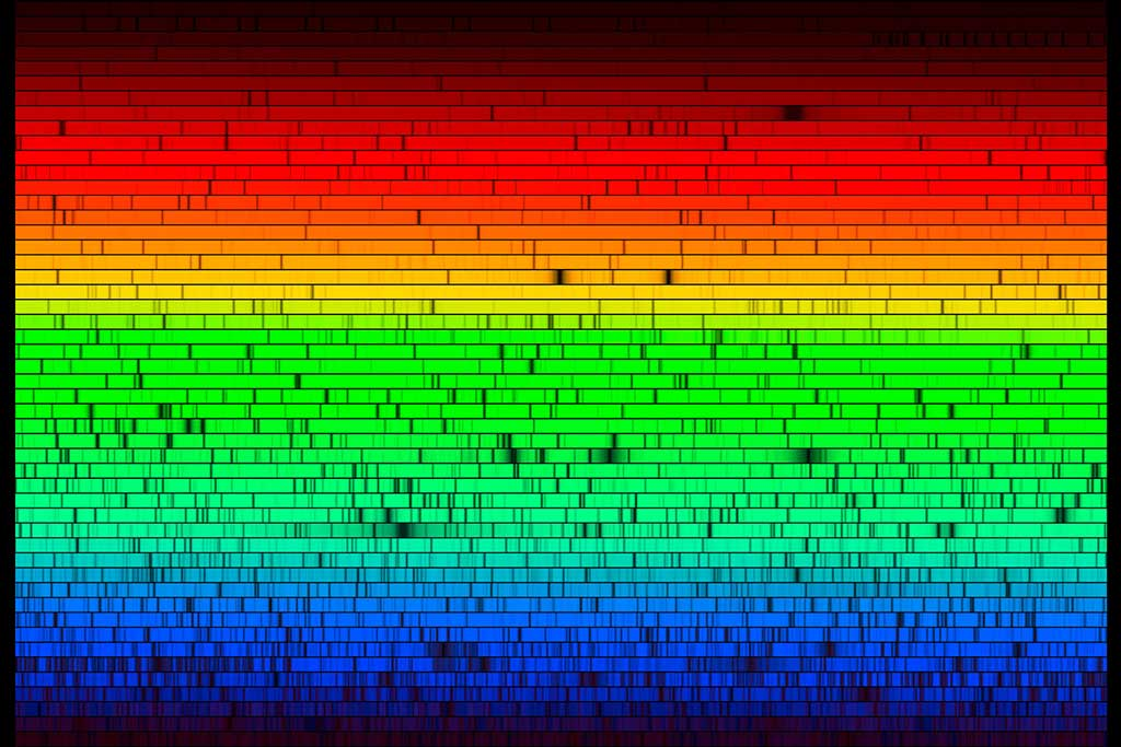 """The """"barcode of the Sun"""" is shown. A very long spectrum was chopped in small chunks and then displayed one on top of another."""