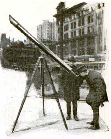 On forty-second street in New York, Joseph G. White shows the new comet or the planets through his 4 ½ inch refracting telescope.