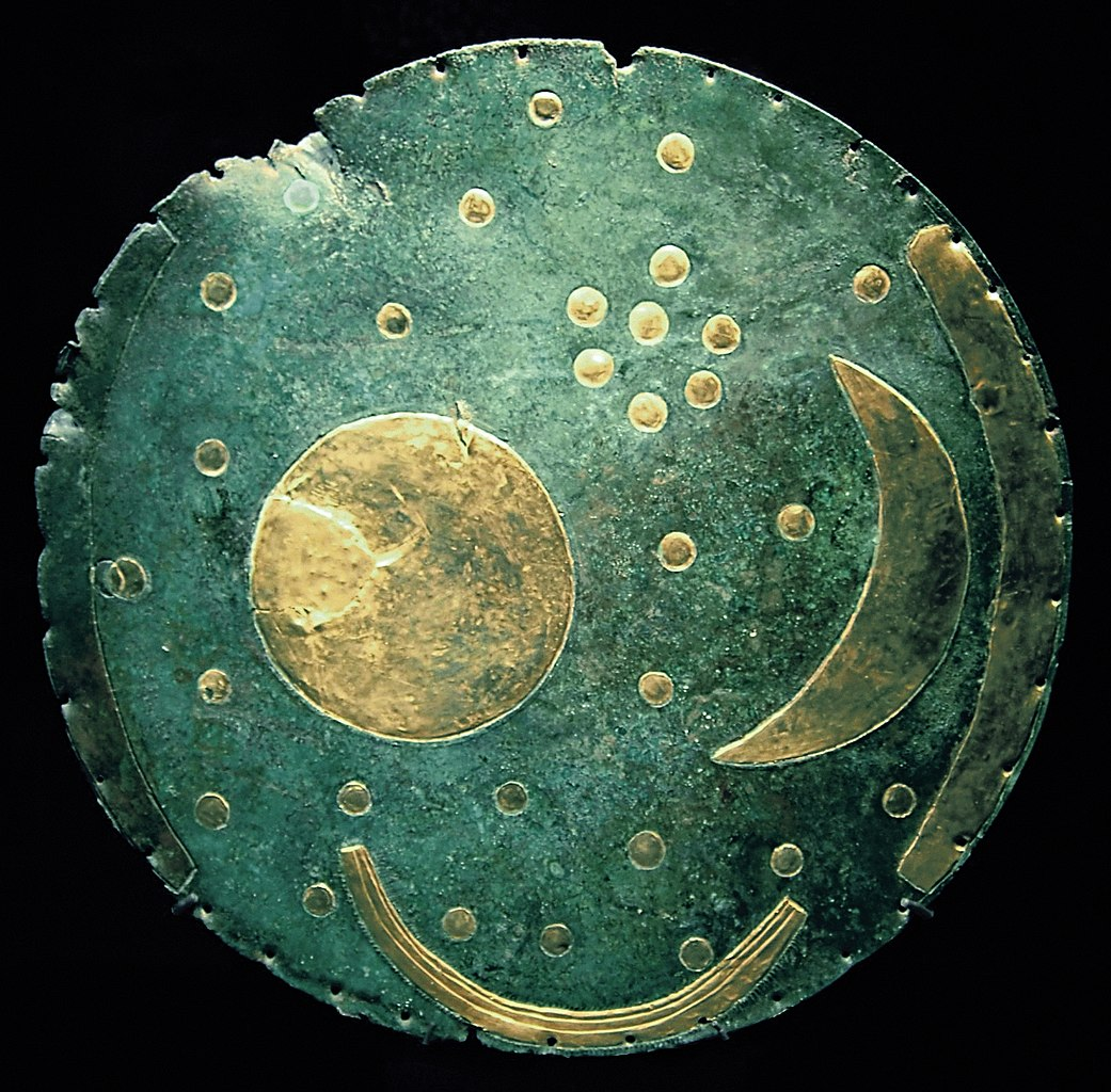 A bronze disk, ca. 1600 BC, from Nebra, Germany is shown with the sun, moon, and stars.
