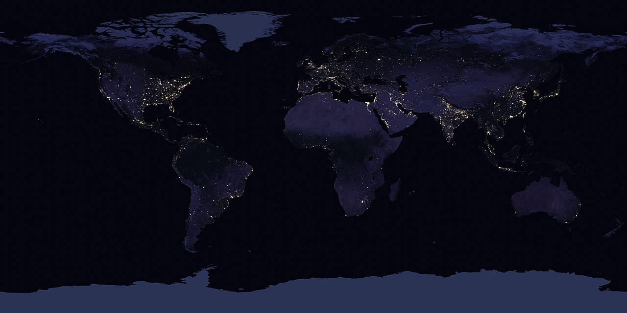 Dots of light across the globe are shown where larger cities are located.