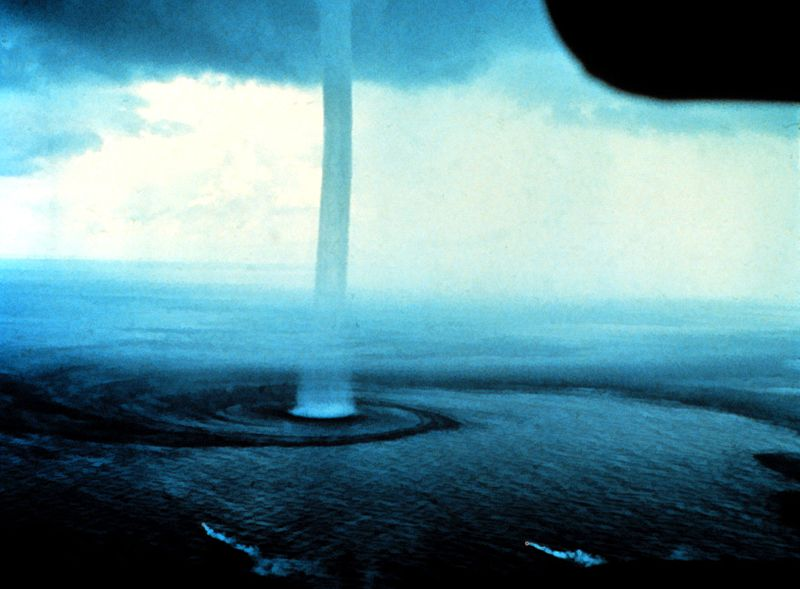 a narrow waterspout is shown.
