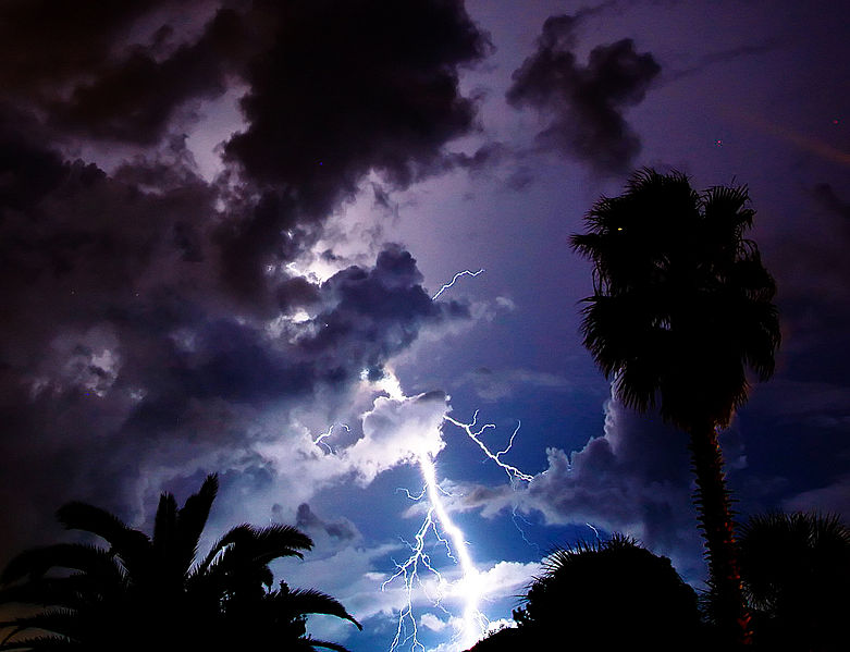 Lightning is shown in the sky.