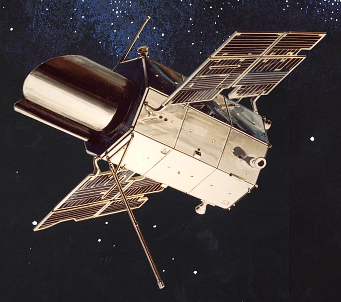 Artist's concept of the Orbiting Astronomical Observatory in orbit appears as a large main vessel with 4 solar panels on each side.