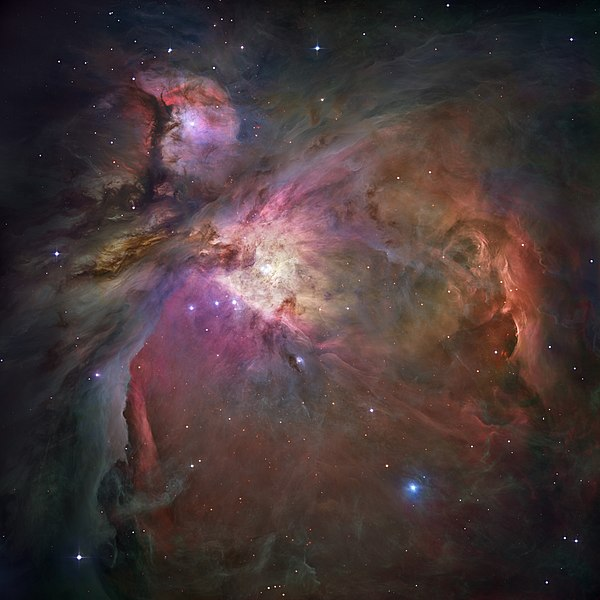 Within the Nebula, new stars are condensing out of interstellar clouds. The young stars in turn light up the surrounding cloud, exciting atoms in the cloud into radiating light.
