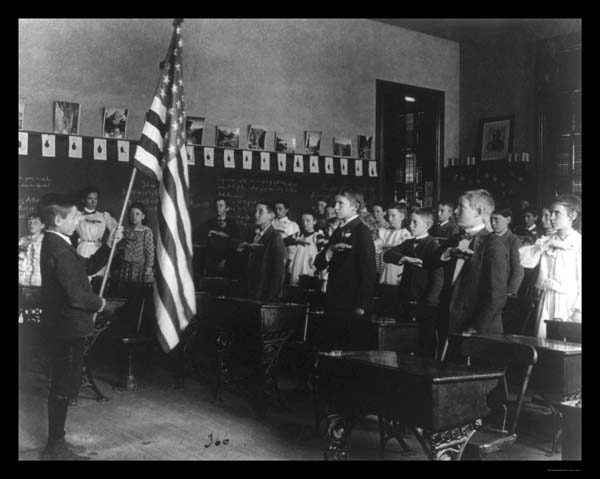 Students pledging to the flag with the Bellamy salute, March 1941.