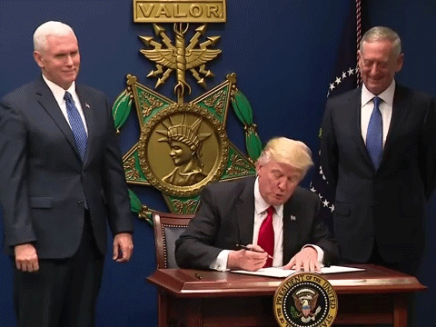 U.S. President Donald Trump signing the 'Protecting the Nation from Foreign Terrorist Entry into the United States' order, flanked by Vice President Mike Pence (left) and Secretary of Defense James Mattis (right).