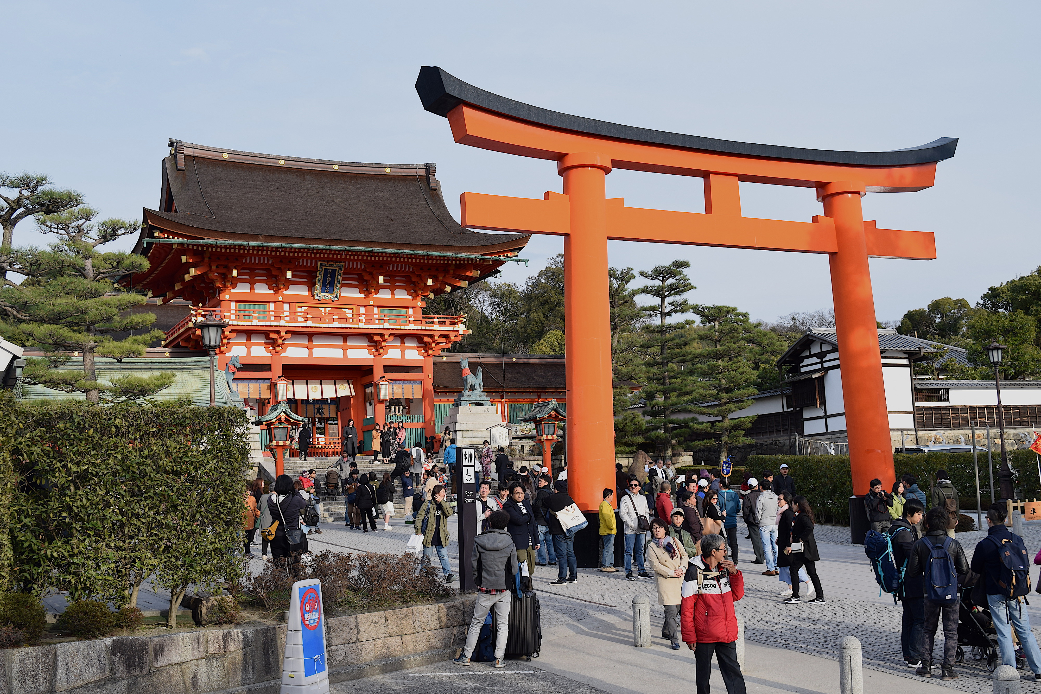 The Fushimi Inari Shrine is the largest shrine. It is famous for the large number of red gates (torii) at the site. Further described in text.