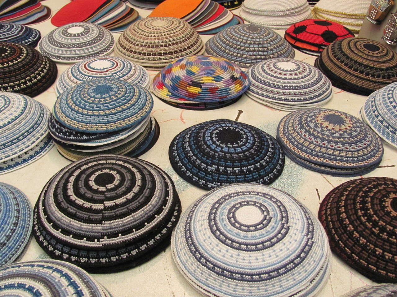 Handmade yarmulkes at a stand in the Old City of Jerusalem. Yarmulkes are described in text.